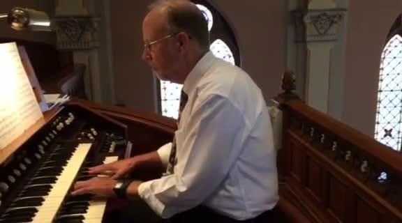 Dr. John Behnke plays the organ at Trinity Evangelical Lutheran Church.
