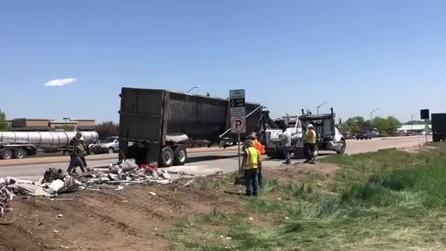 A truck carrying scraps of metal was turning and overturned on Wednesday, May 17, 2018, blocking lanes at the intersection of Mulberry and Lemay.