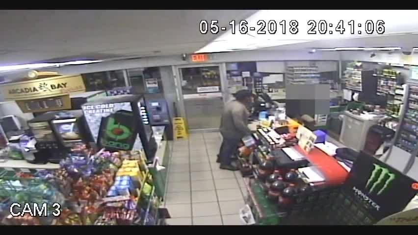 Police are asking for the public's help to identify a man caught on surveillance cameras during an armed robbery May 16.