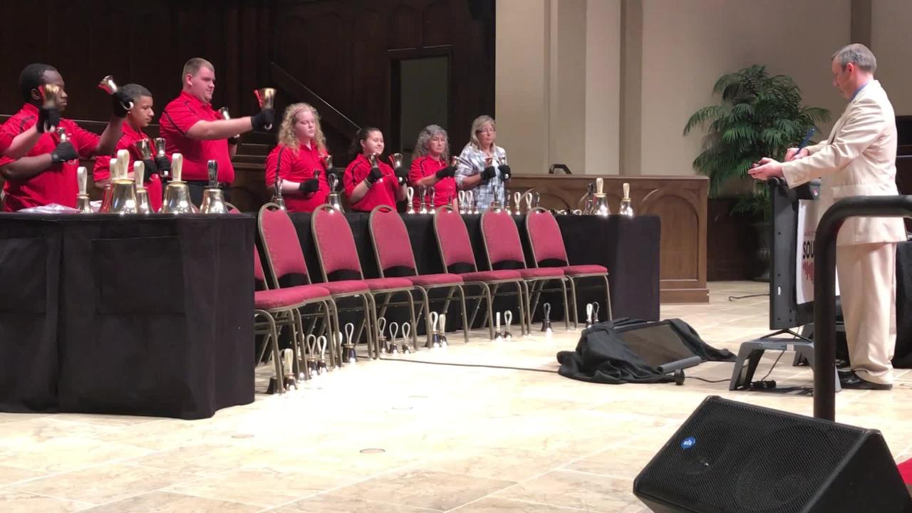 Abilene ISD's handbell choir, under the direction of Eric Logan, performs a piece during its 40th anniversary program Tuesday, May 15, 2018.