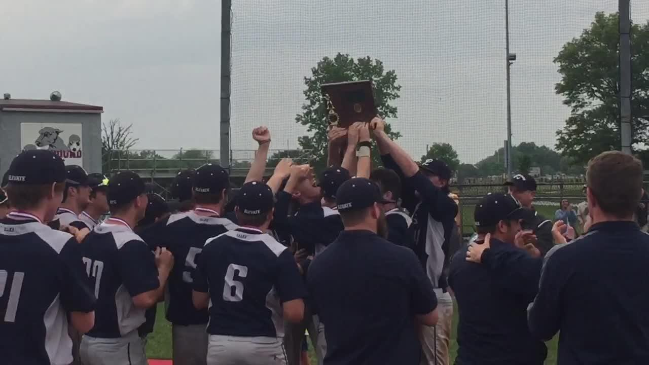 Lancaster baseball team receives Division I District championship trophy.