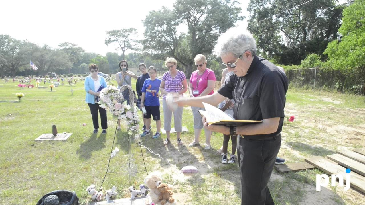 Teachers, classmates, and friends gathered for a memorial service at the grave of 9-year-old Dericka Lindsay to bless and dedicate a permanent marker in Resthaven Gardens Cemetery in Pensacola on Friday, May 18, 2018.