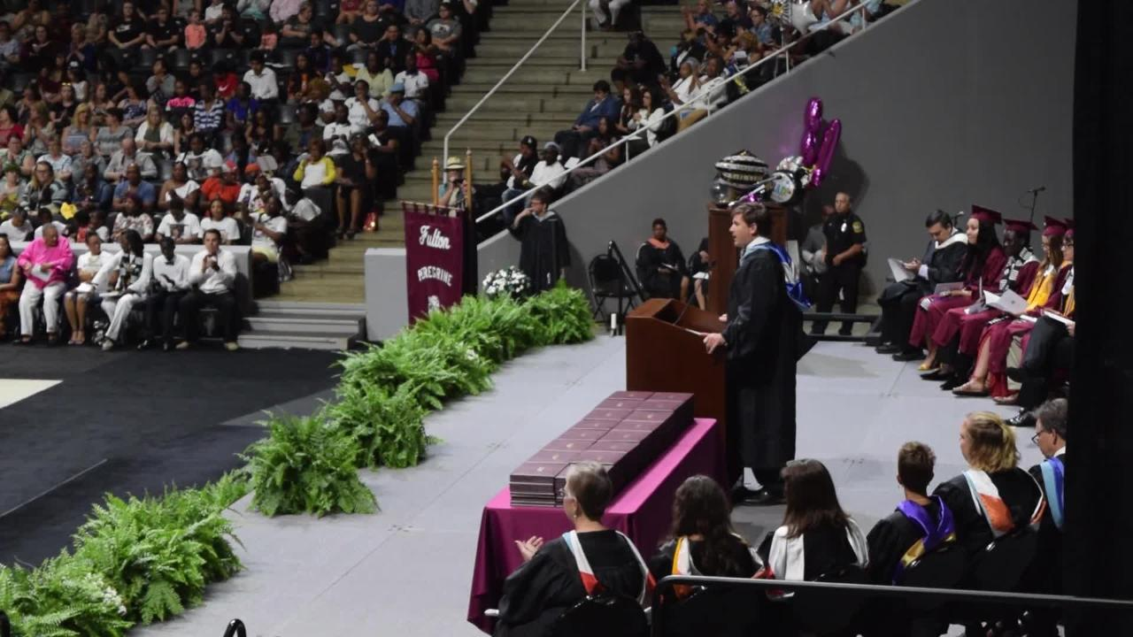 Fulton High reserves a chair for Zaevion Dobson at its graduation ceremony  at Thompson-Boling Arena.