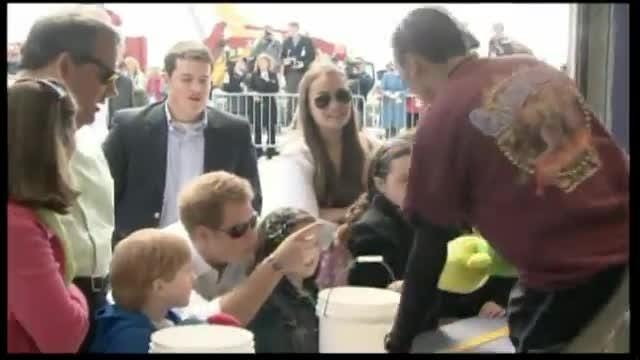 New Jersey Governor Chris Christie accompanies Britain's Prince Harry to Seaside Heights, a beach town hit by Hurricane Sandy.