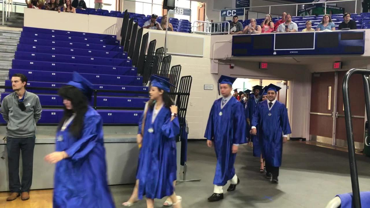 Gateway Charter graduates march into Alico Arena for their graduation on Sunday.