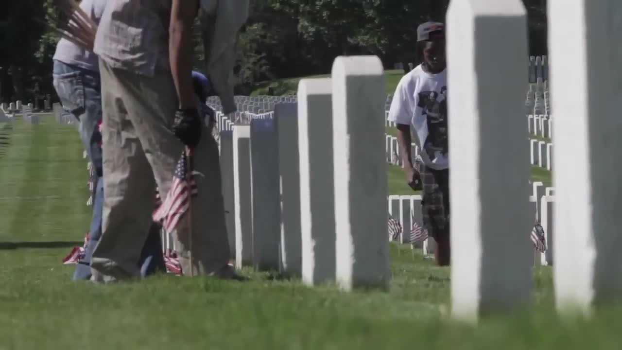 Every year flags are placed on every grave at Wood National Cemetery by groups from across the area.