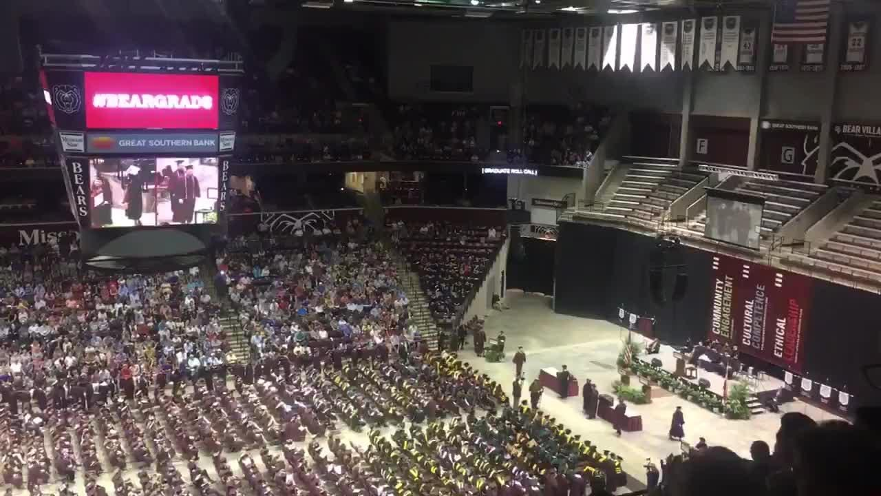 Even though he's never been enrolled at MSU, local comedian Jaron Myers handed a name card to the lady calling names and he walked across the stage during Missouri State's graduation.