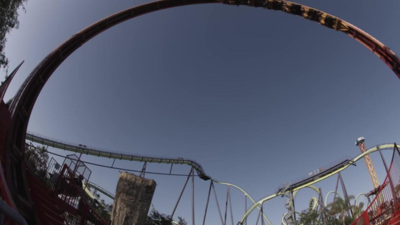 Riders travel 360 degrees on Six Flags' new Mardi Gras Hangover roller coaster.