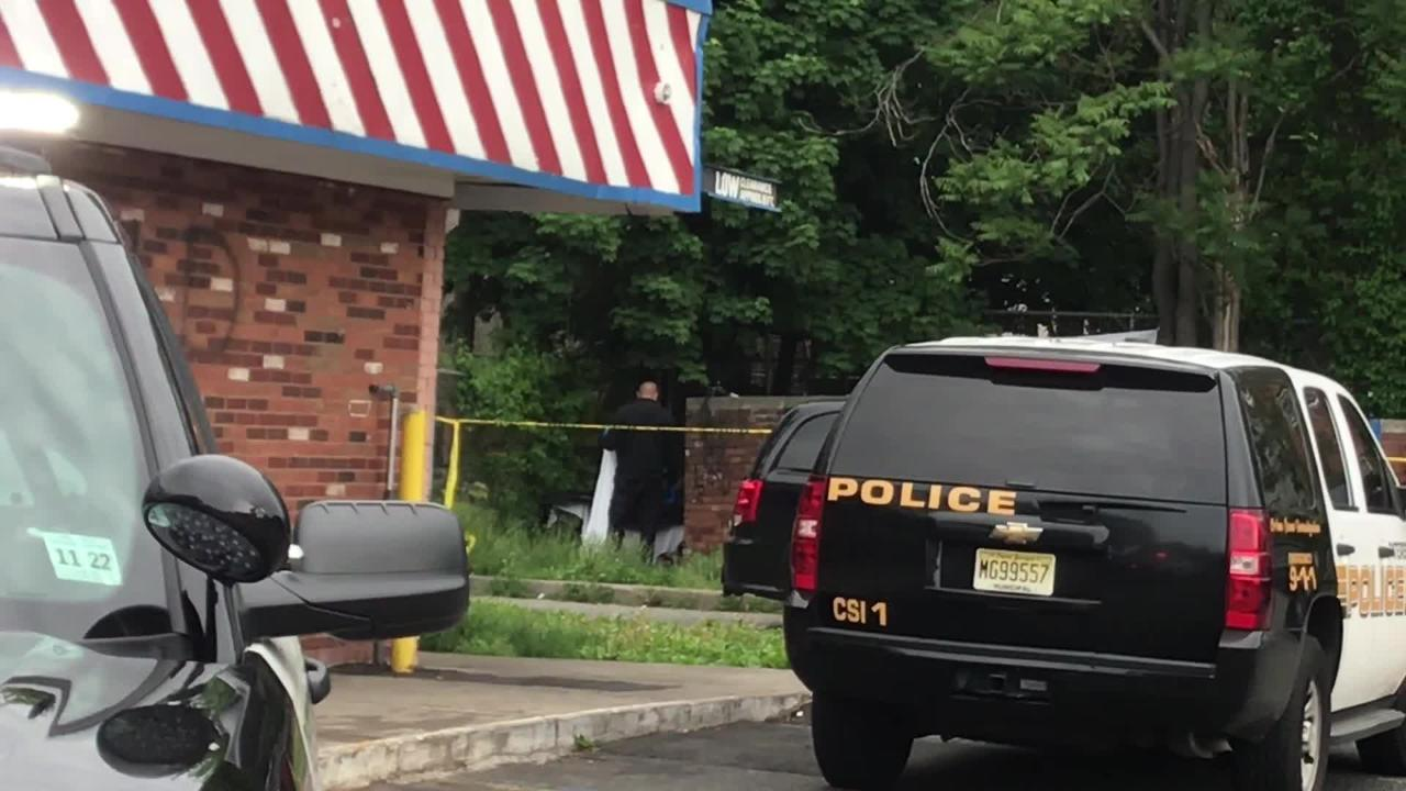 A body was found behind a dumpster if the parking lot of American Fried Chicken in Paterson Tuesday morning.
