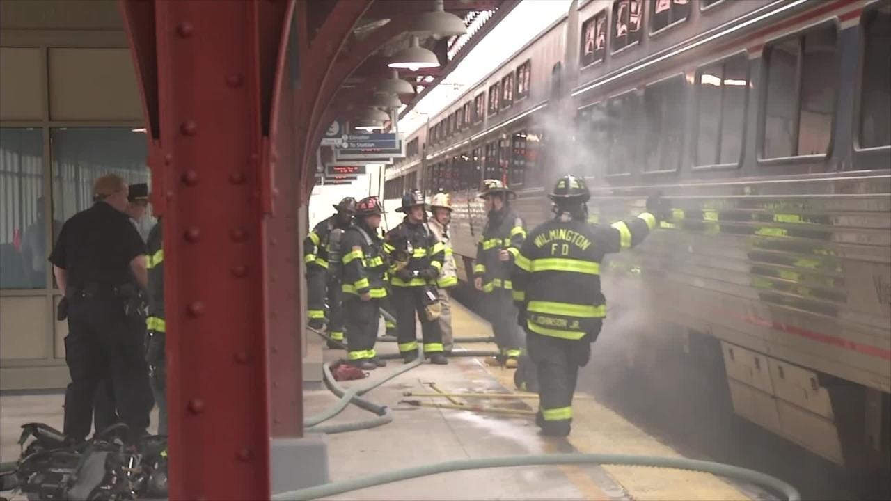 Raw Video: Wilmington firefighters put out train fire at Amtrak Station