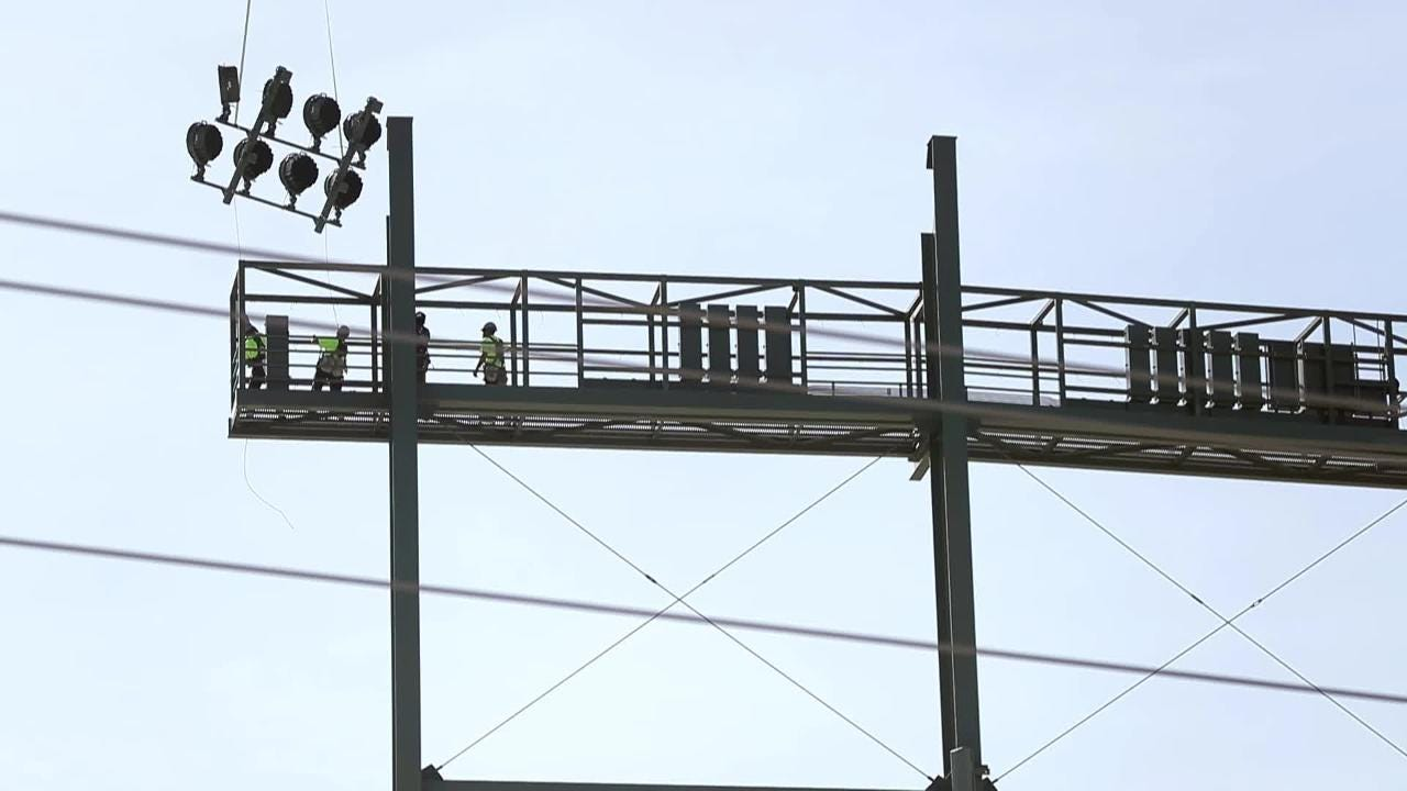 With the help of a helicopter, new stadium lights were installed at Lambeau Field on May 23, 2018.