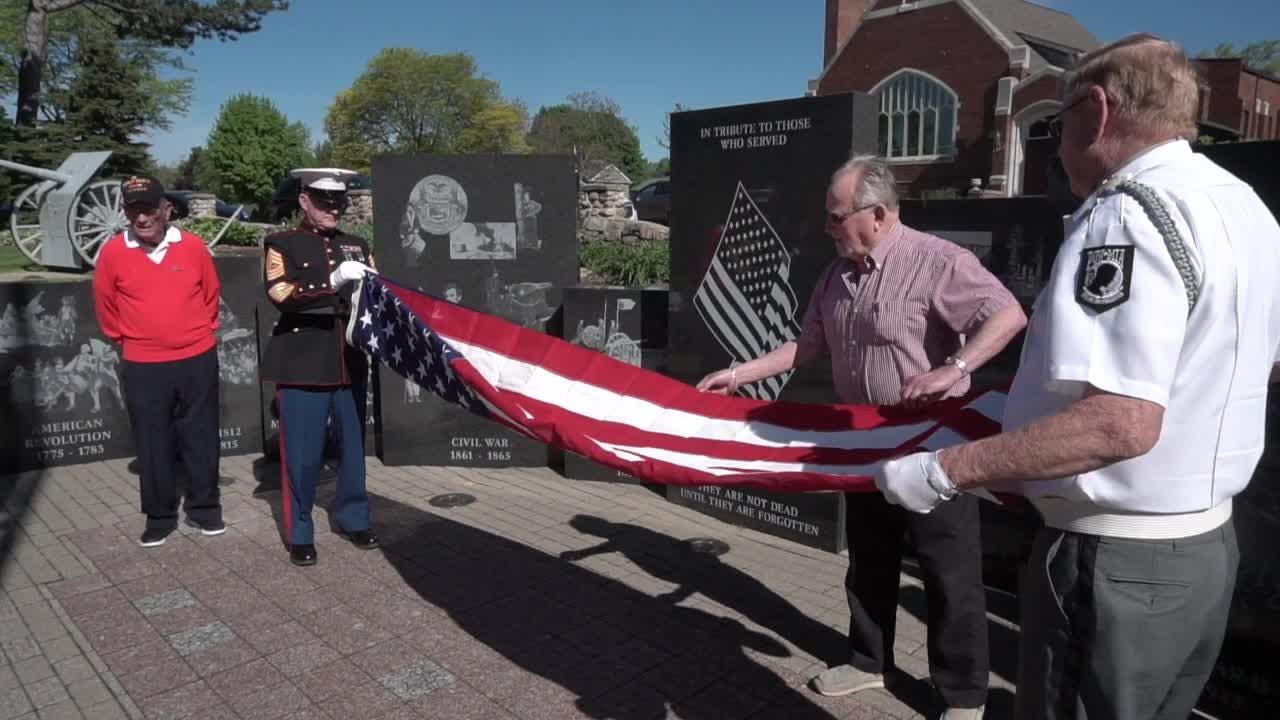 Veterans who volunteer at the Ann Arbor VA hospital schooled Bird Elementary first graders on how to fold the flag. Volunteer Jodi Ring explained why.