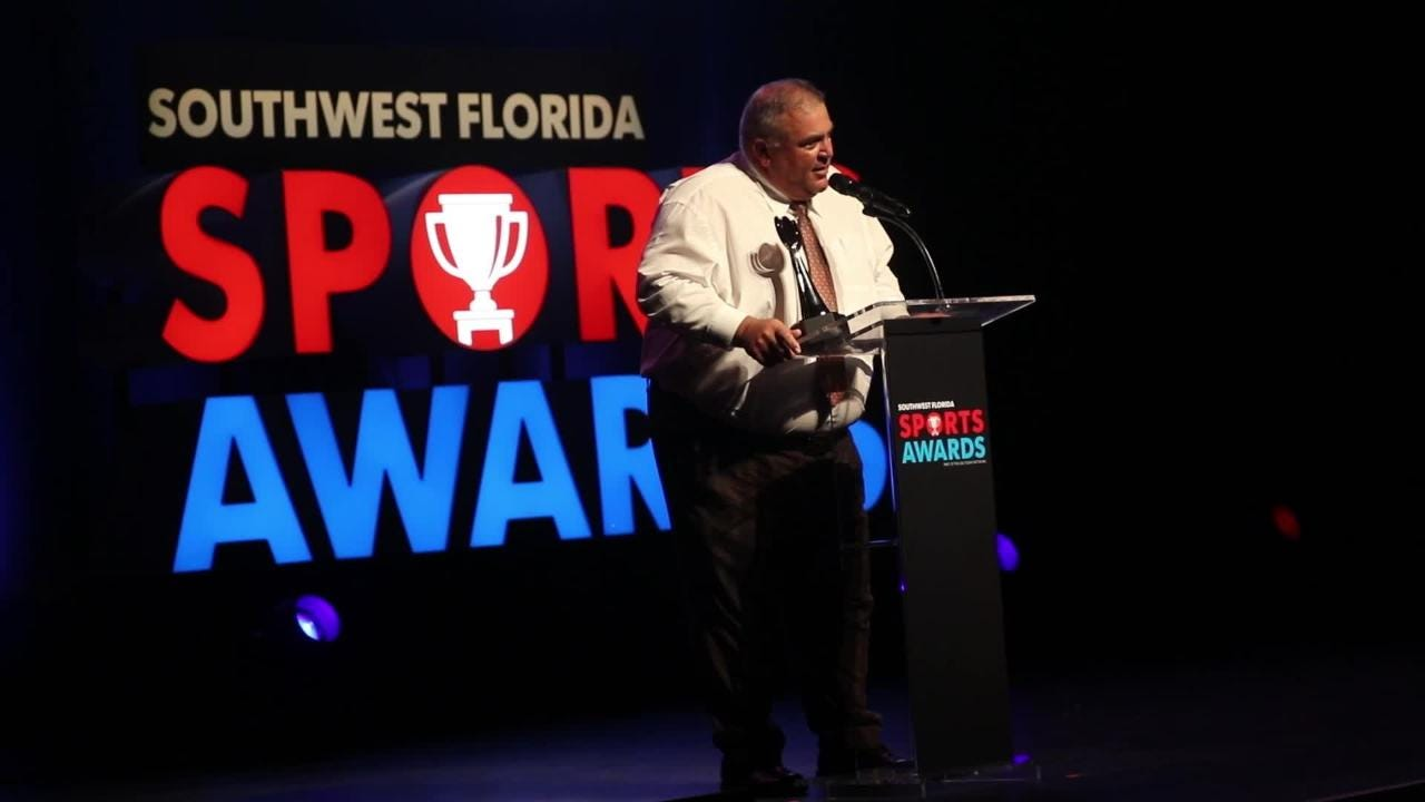 Sam Sirianni Jr. accepts the Jeff Sommer Memorial Coach of the Year Award at the Southwest Florida Sports Awards Wednesday night.