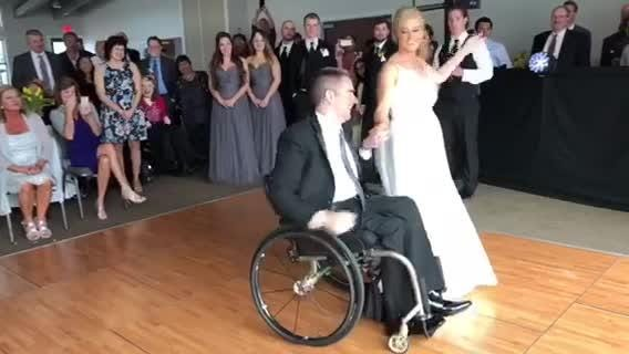 A South Lyon dad got to dance with his daughter at her wedding, 27 years after being confined to a wheelchair in a robbery attempt.