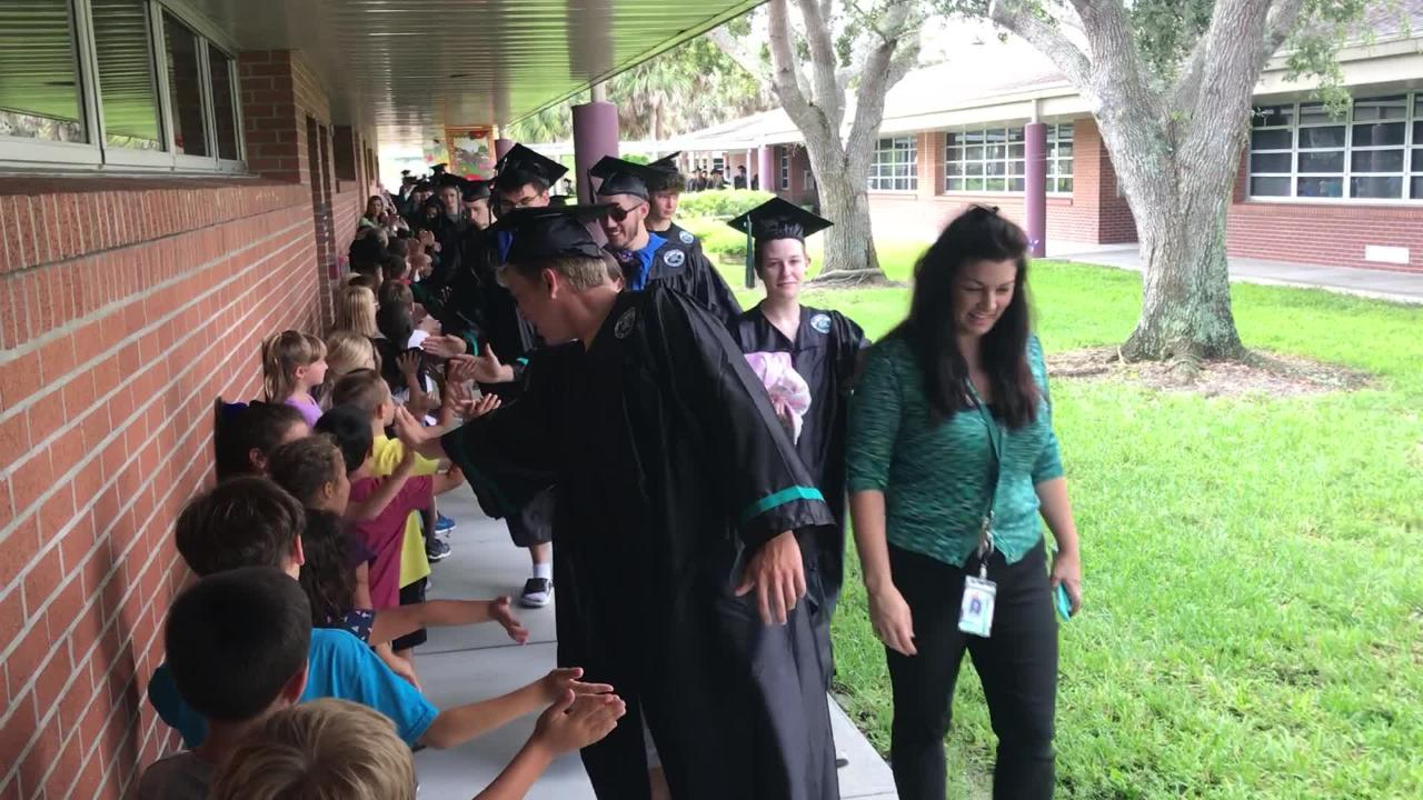 Laurel Oak Elementary students cheer on Gulf Coast High School seniors as part of Collier County Public School's annual graduation walk event.