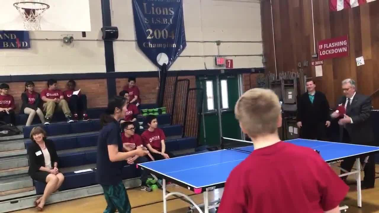 """That time Rider University president """"beat"""" Olympic table tennis coach Lily Yip. They played a few rounds of table tennis at Freehold Borough Schools."""