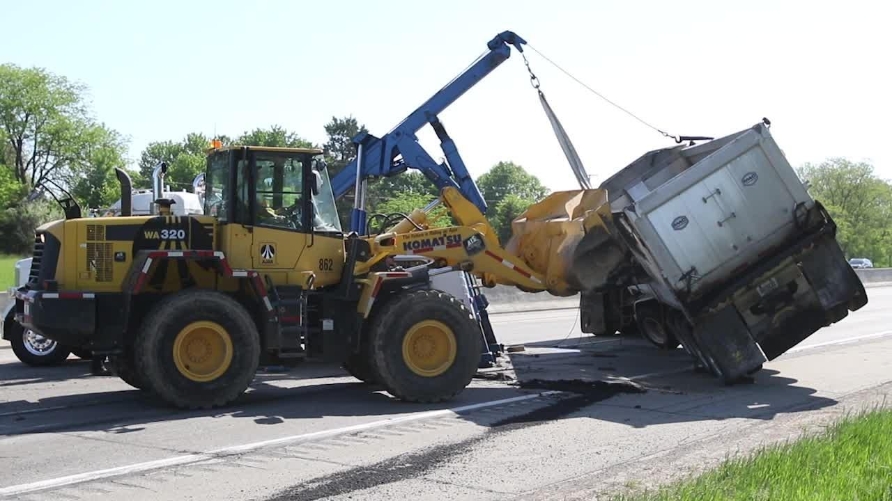 An asphalt hauler rolled over on eastbound I-96, spilling its contents onto the freeway. The road was closed eastbound for several hours for cleanup.