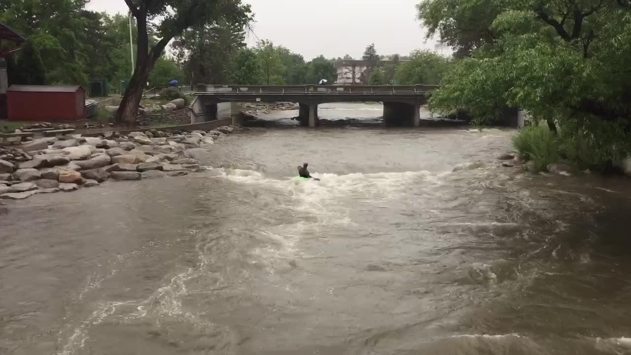 A lone kayaker braves the rushing Truckee River during heavy rain Friday, May 25, 2018 in downtown Reno.