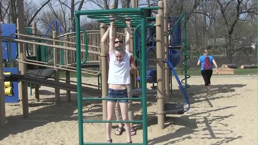 In Motion: Monkey bars can be a family exercise