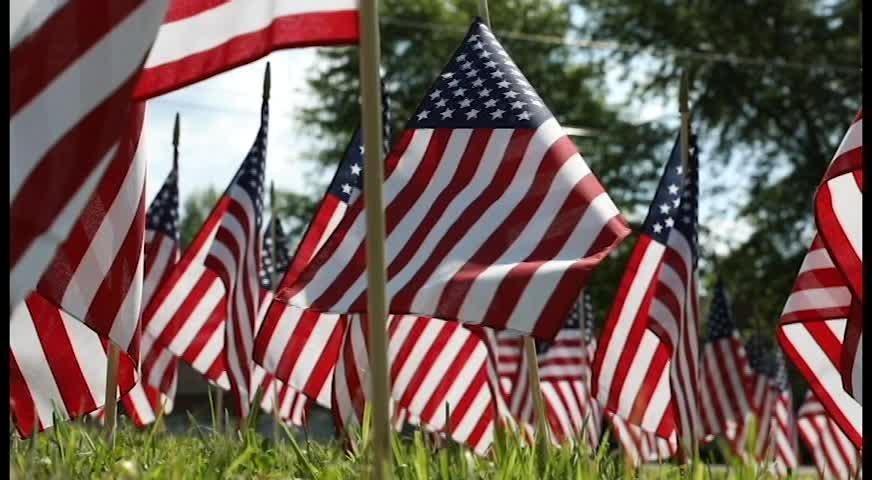 A cross of flags honors veterans
