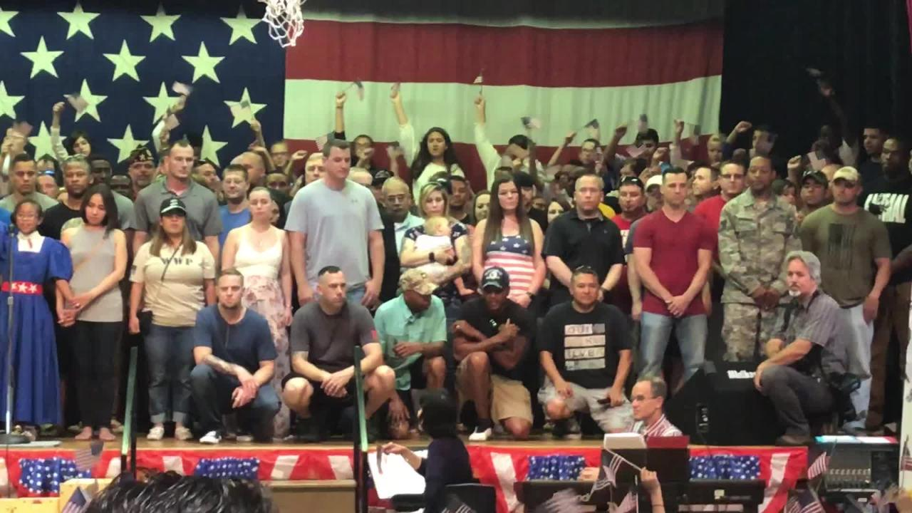"""Active duty military members, along with veterans, stood on stage during the Dyess Elementary """"I Love America Day;"""" thanked by singing students"""