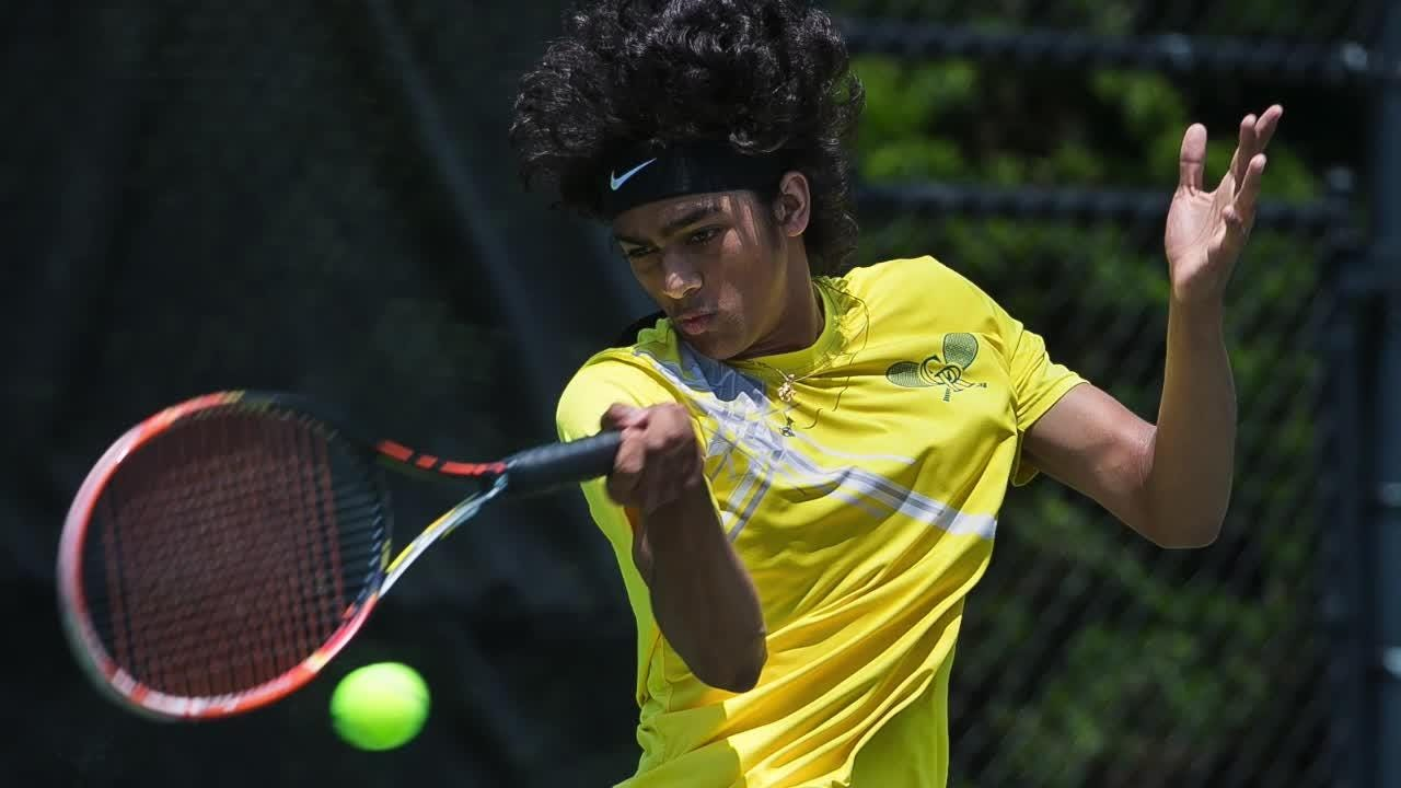 Richi Gundakaram of Caesar Rodney wins the boys first singles in the Finals of the DIAA Tennis Tournament at St. Andrew's School in Middletown.