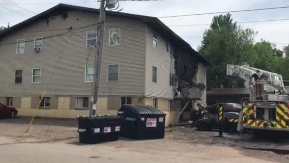 Firefighters battle an apartment building fire on Wausau's east side at 10th and Thomas streets. (May 27, 2018)