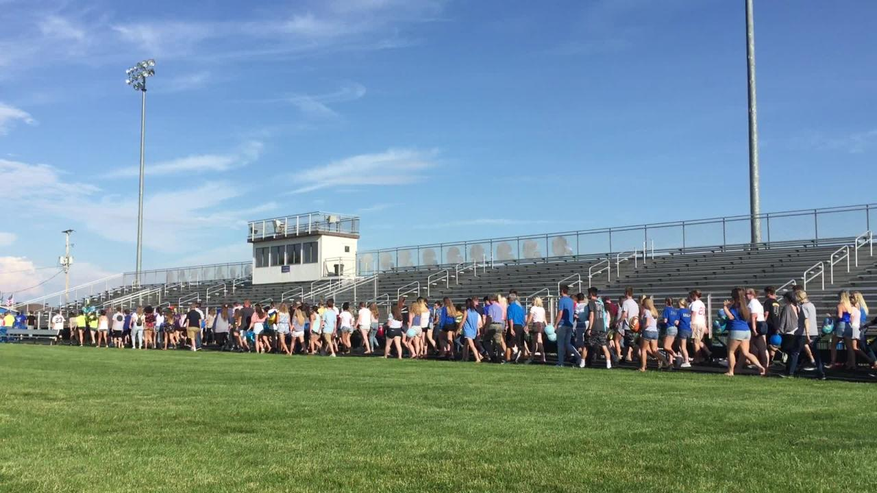 Friends and family did a 400 meter lap around the track at West Muskingum High School on Tuesday, during a vigil for the late Cameron Strauss. The 400 meter was Strauss' specialty while on the West M. track team.