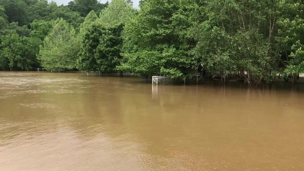 Waters overflowed from the Swannanoa River and covered a popular East Asheville soccer complex.