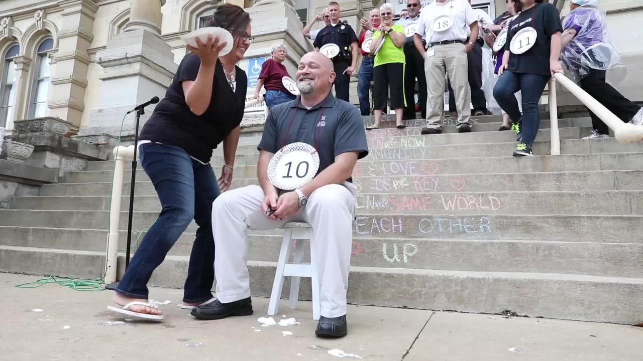 Local celebrities get pies in the face to raise money for Operation Feed.