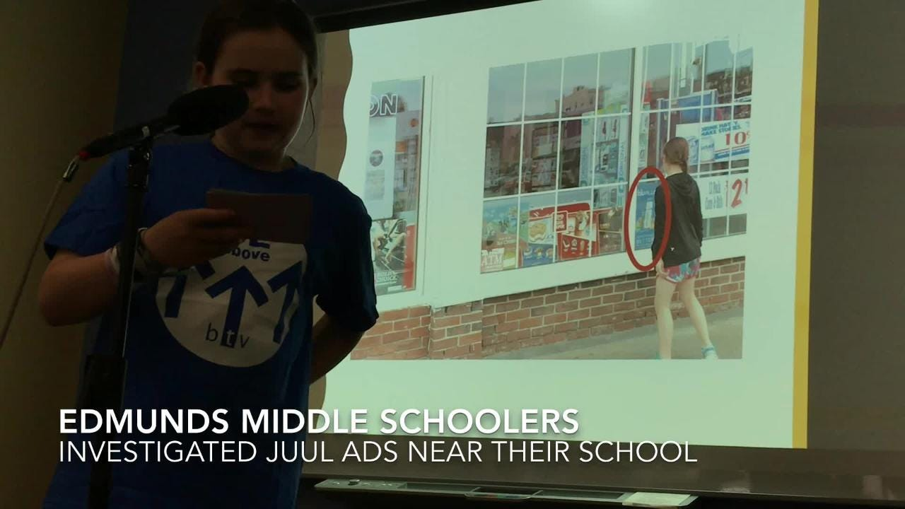 Burlington middle school students present an investigation into ads for Juul e-cigarettes they spotted around their school.