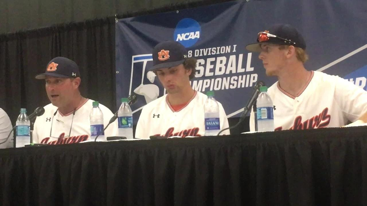 Auburn coach Butch Thompson and players (Edouard Julien, Steven Williams and Tanner Burns) after NCAA Regional win.