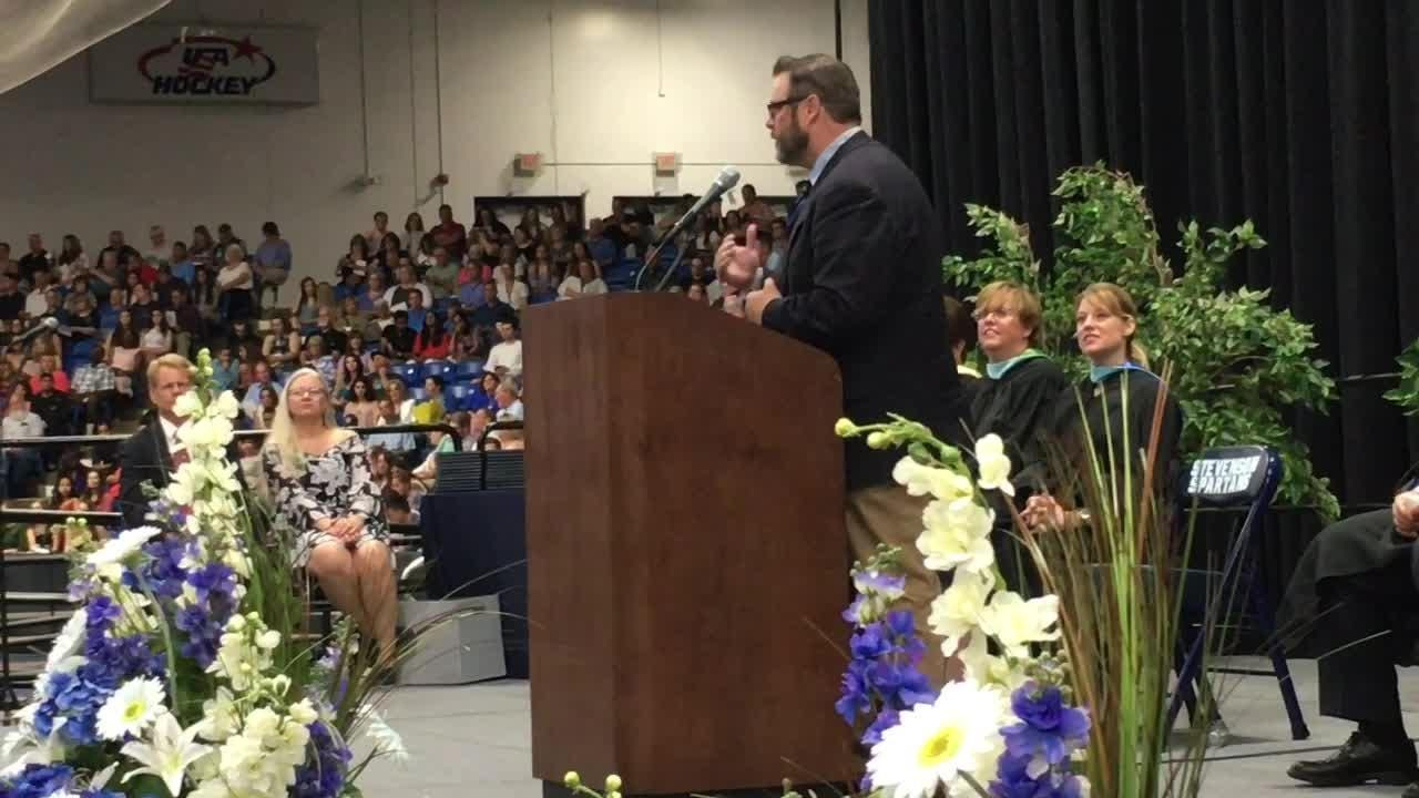 Graduates crossed the stage and received their diplomas on Friday evening.