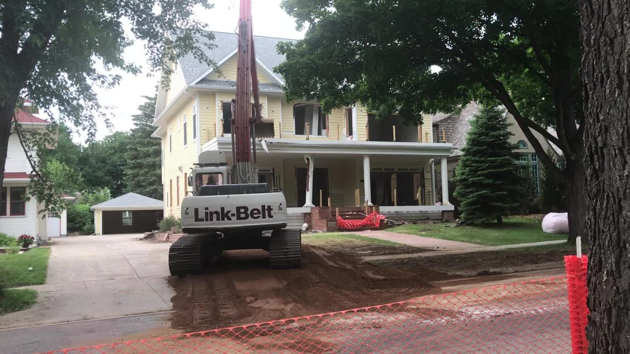 The McKennan Park home was demolished on Thursday after a four-year dispute between neighbors about the size of the house.