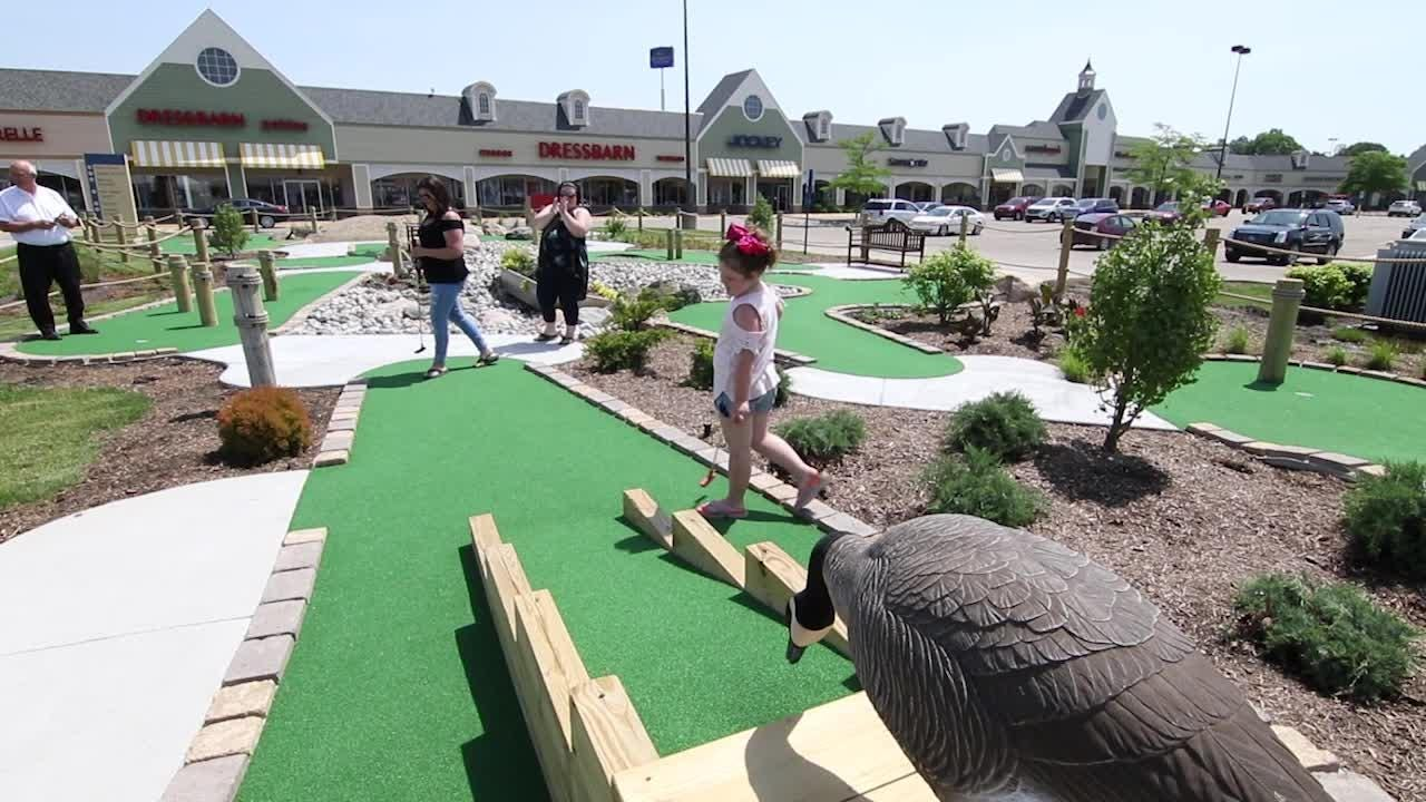 5-year-old JoDee Showerman and her mom Brie try their hand at miniature golf at Tanger Outlet in Howell.