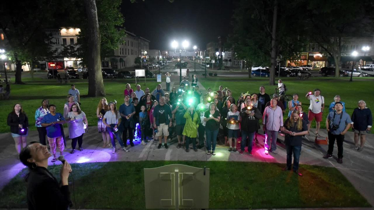 Members of the LGBTQ community and allies use gelled flashlights to light the Licking County Courthouse during the People's Pride Light event on Friday, June 8, 2018.