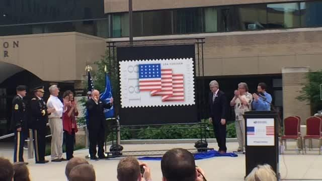 Pat Mendonca, senior director of the Office of the Postmaster Generaland chief executive officer, speaks about new postage stamp.