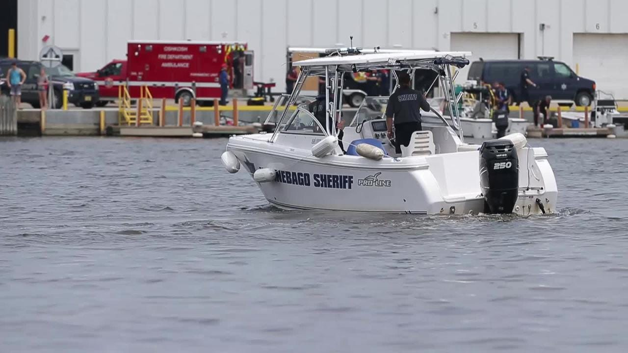 Sheriff's department boats search Fox River after helicopter crashes.