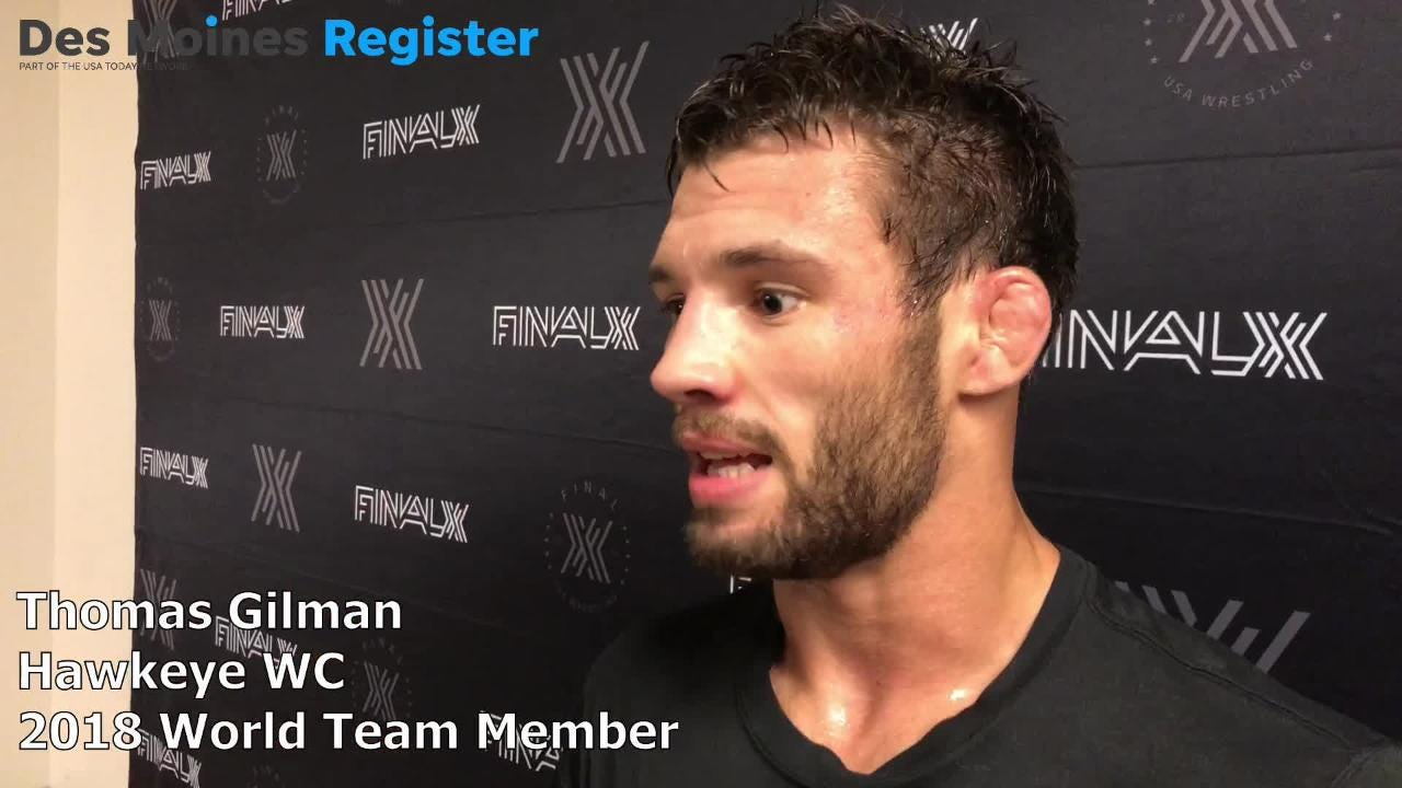 Thomas Gilman, a three-time All-American wrestler for Iowa, swept his best-of-three final against Daton Fix to qualify for the men's freestyle world team on Saturday in Lincoln.