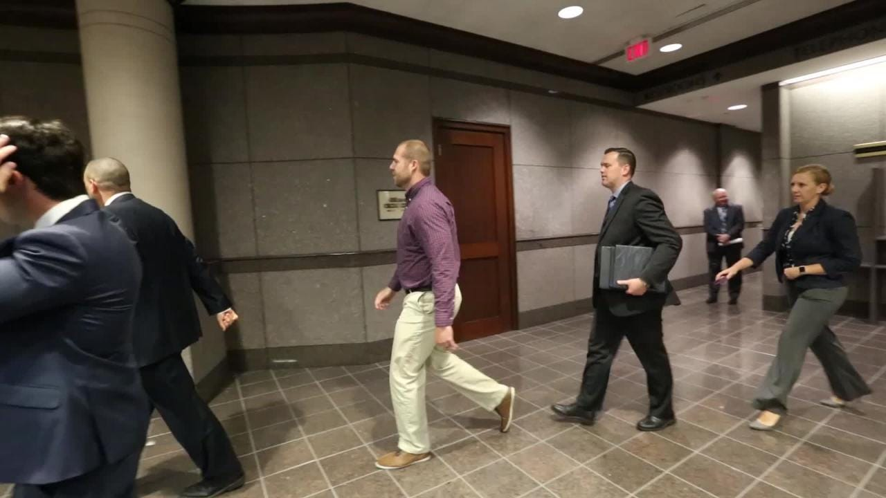 NWMS teacher and shooting victim, arrives at court for accused shooter's initial hearing.