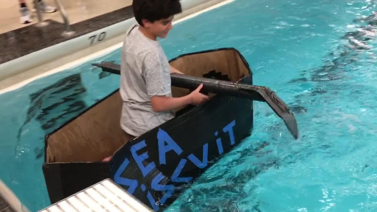 Students designed and built boats and paddles from cardboard and lots of duct tape. Most floated pretty well.