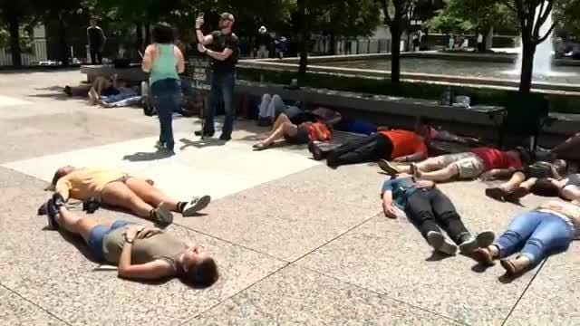 "Students hold ""die-in"" at the Legislative Plaza"