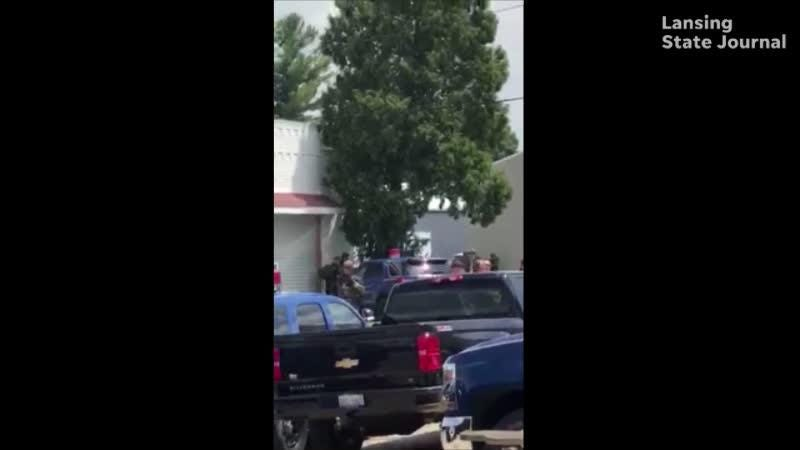 A suspect barricaded himself inside a box truck after fleeing from a fugitive team who went to arrest him this morning, a Michigan State Police official said. Warning: Adult language.