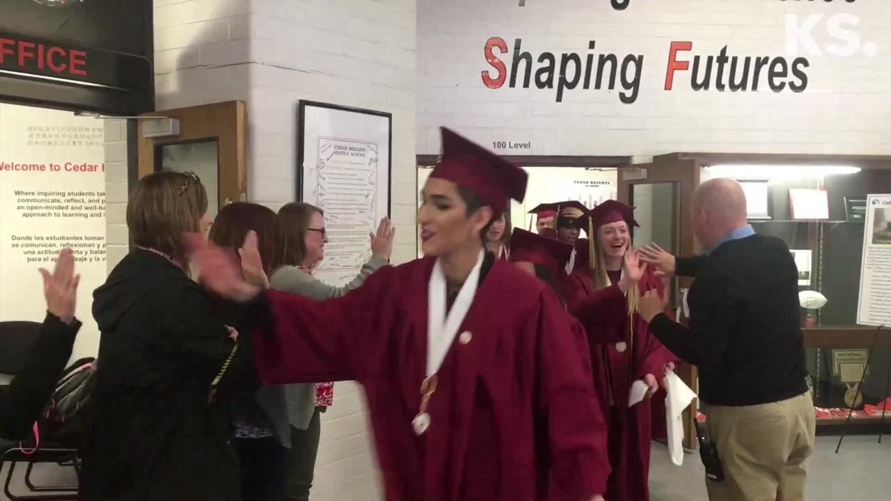 South Kitsap High School graduates visited their old middle school before graduation, June 12, 2018