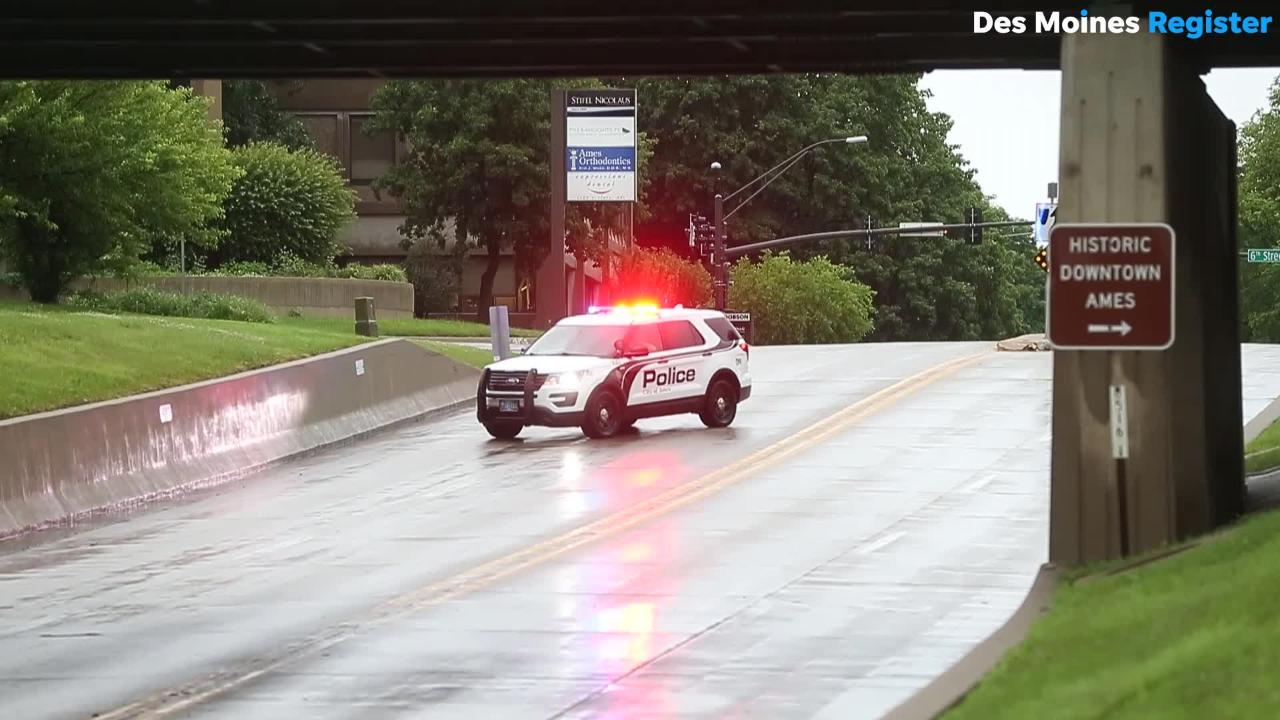 A U.S. Postal Service truck was stranded on Grand Ave. under an overpass in Ames during a flash flood Thursday morning.
