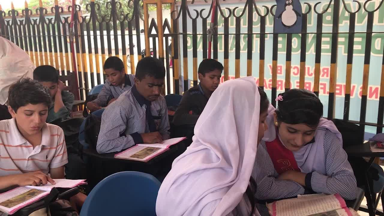 The Footpath School -- under a bridge --serves street children in Pakistan. The school provides meals, medical care and other essentials for the kids.