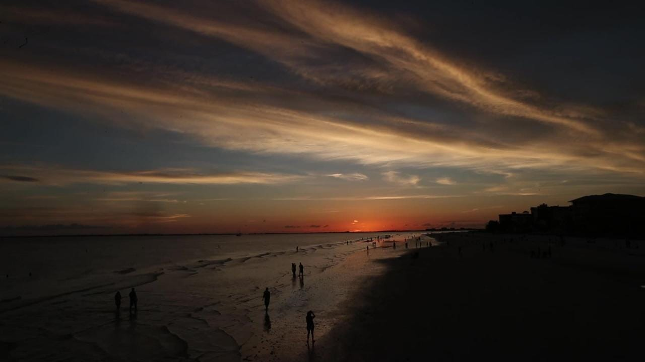 Summertime sunsets on Fort Myers Beach are worth the drive over the bridge. Watch the ball of fire disappear.