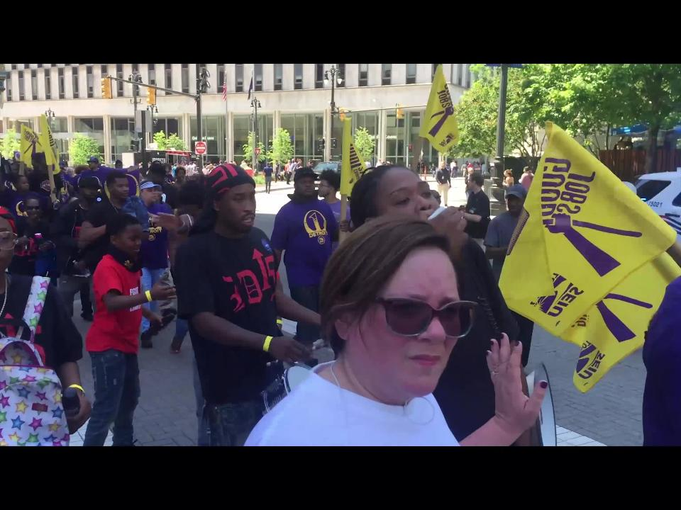 Members of the Service Employees International Union Local 1 Detroit rally for higher wages in downtown Detroit on Thursday, June 14, 2018.