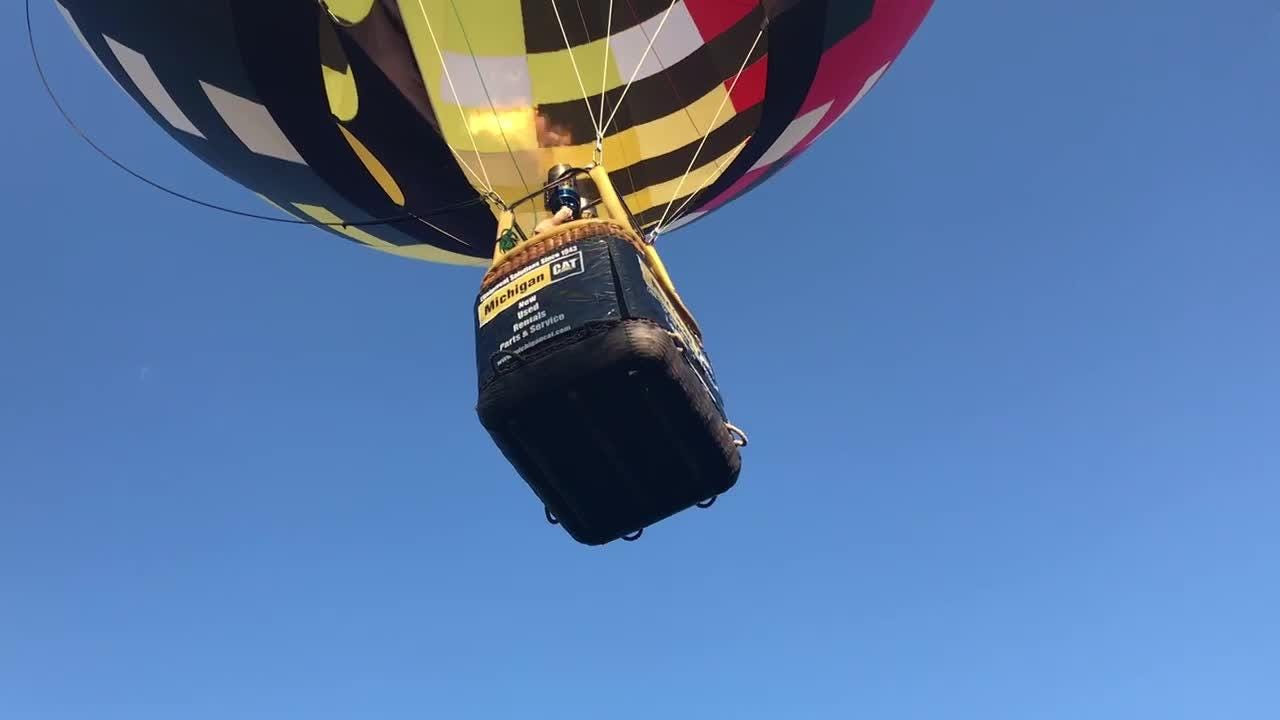 Balloon pilot Rick Kerber from Wayland Michigan takes off in his balloon Wednesday June 13 at the Michigan Challenge Balloonfest media night.