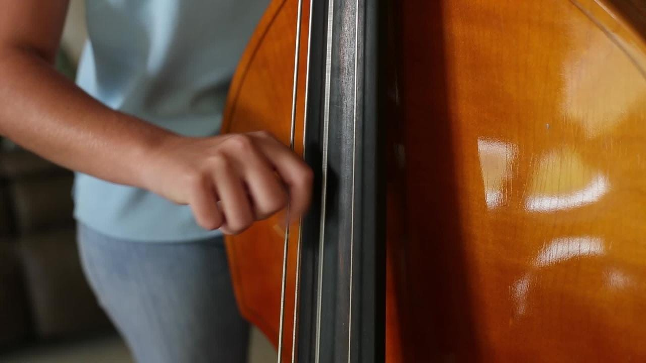 After losing her instrument to Hurricane Maria, Nichelle Agosto touched by new upright bass